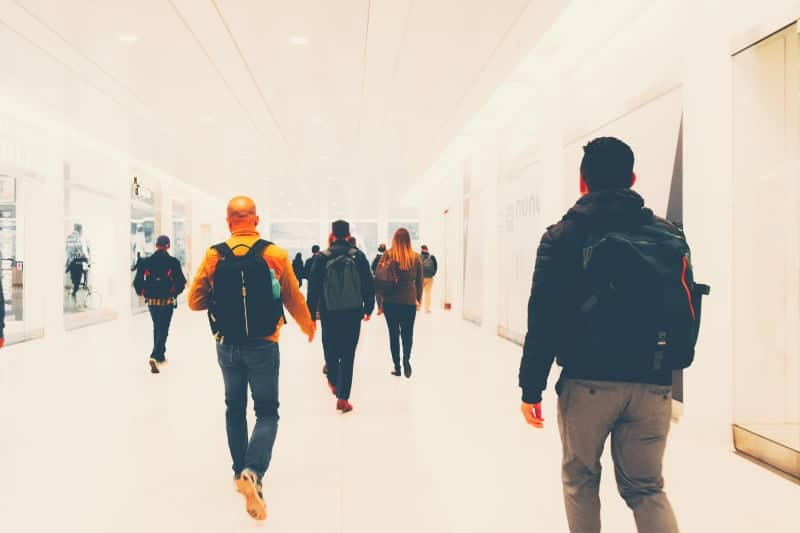 Men Carry backpacks in the airport